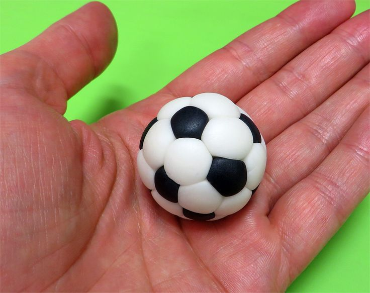 Fondant soccer ball in hands close