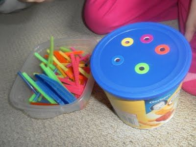 With a jar from the recycling bin, I punched holes in the lid and used coloured hole reinforcement stickers to label each hole a colour. I cut up the same colour in pipe cleaners and straws.