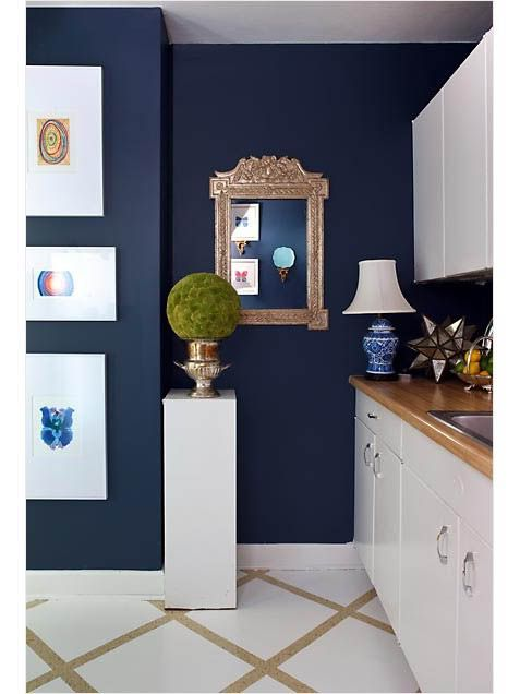 Navy blue kitchen, with butcher block counter tops.