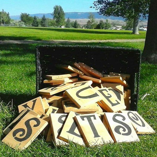 Spell f-u-n. Challenge your guests to a game of giant lawn Scrabble.