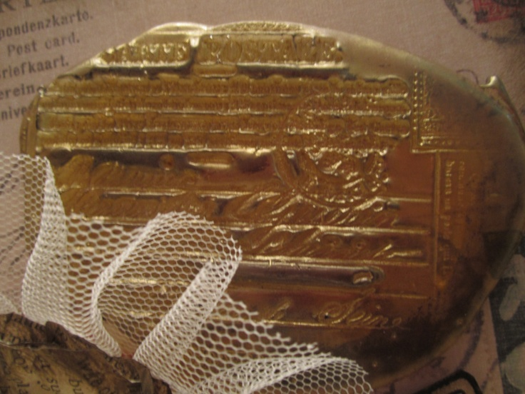 Clear UTEE heated and stamped with a postcard stamp, gold brilliance ink, then gold rub n buff