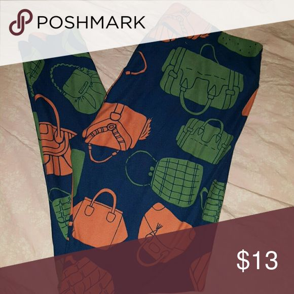 LuLaRoe Purses TC Leggings A pair of gently worn TC leggings with a navy background and peach and green pocketbooks.  Washed per instructions. LuLaRoe Pants Leggings