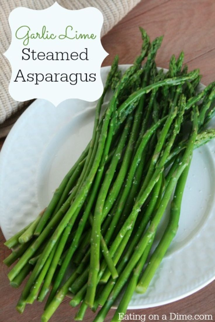 This Garlic Lime Steamed Asparagus  recipe can me made in under 10 minutes. Plus it tastes amazing! Buy Asparagus in season to make this a very frugal side dish. http://eatingonadime.com/garlic-lime-steamed-asparagus/ #healthyeating #asparagus