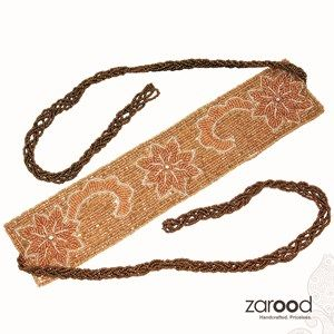 """We have zarood have created a team of such craftsmen who are skilled in this art form and have created such wonderful items like this """"Golden Flower Belt"""". Zardozi is an ancient decorative embroidery art form. It was popularized by the royals in India and Persia. Over the years the numbers of artists who excel in this art form have diminished and are now a rare breed to find."""