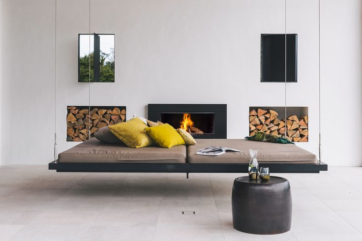 An Escea outdoor cooking fire looking stunning with a day bed