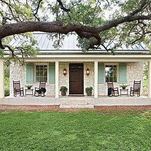 This casual Hill Country cottage pours on the Southern charm with its familiar farmhouse form, picture-perfect proportions, and inviting front porch nestled beneath a curtain of large oak trees. The stone facade and metal roofing nod back to Fredericksburg's original German-style architecture. We'd love to kick up our feet and wind down our week in this soulful country home.