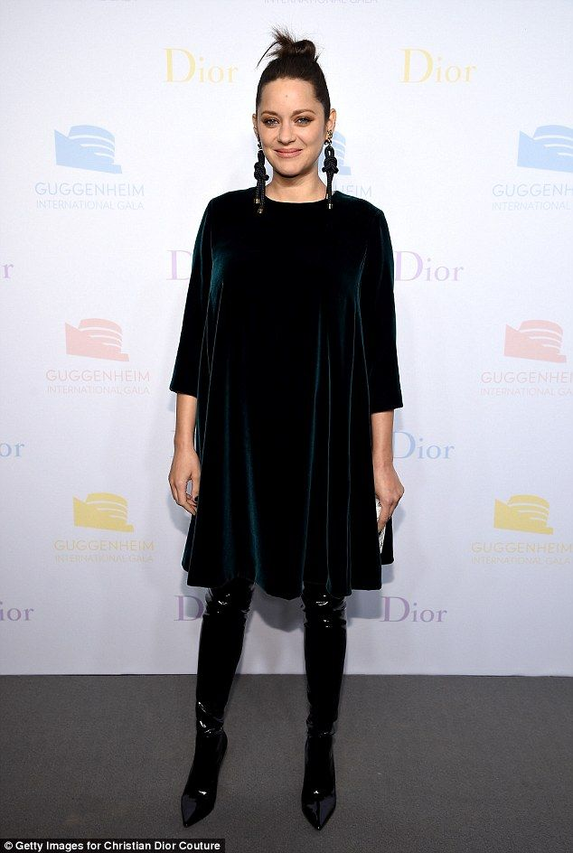 Maternity chic: Marion Cotillard, 41, dressed her baby bump to perfection as she attended the Guggenheim International Pre-Party made possible by Dior at the Solomon R. Guggenheim Museum on Wednesday in New York City