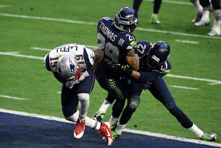 Brandon LaFell #19 of the New England Patriots scores a touchdown over Earl Thomas #29 and Tharold Simon #27 of the Seattle Seahawks in the second quarter during Super Bowl XLIX at University of Phoenix Stadium on February 1, 2015 in Glendale, Arizona.
