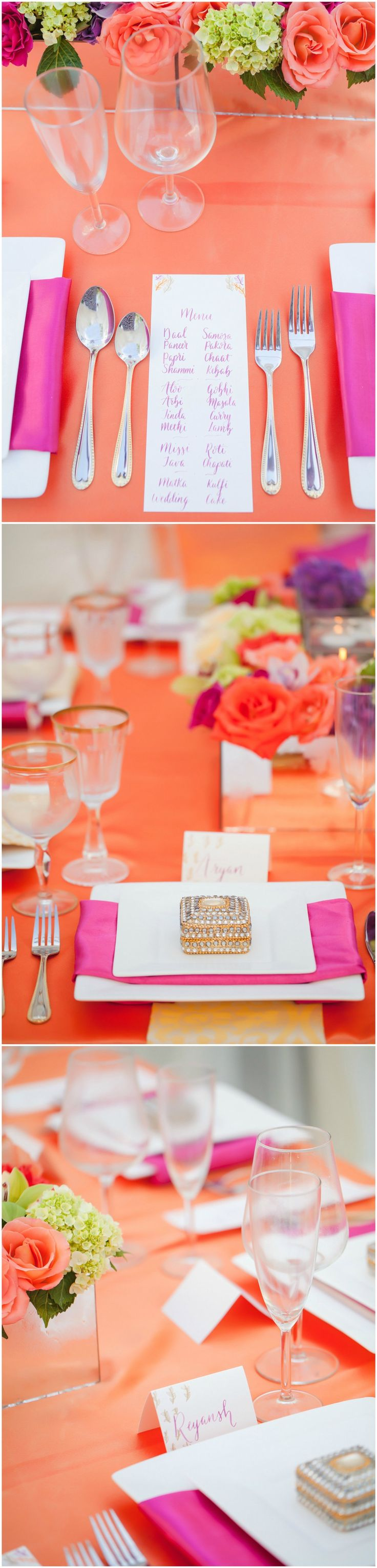Vibrant wedding reception placesetting, orange tablecloths, bright pink napkins, orange roses, pink and white handwritten place cards and menus // Casey Hendrickson Photography
