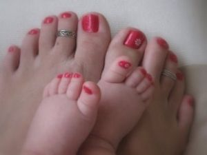 Mommy & baby girl matching pic. Love it because my body doesn't looks so great post baby and feet always look great :)