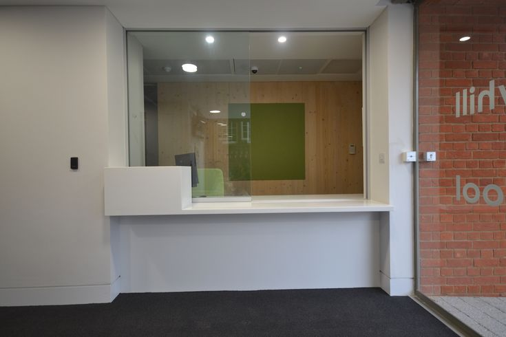 Custom reception desk with sliding glass screen for Linden Education Centre - read more here.