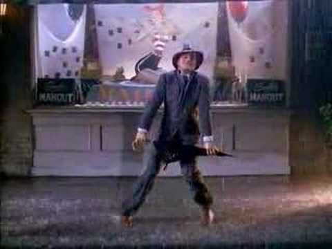 Gene Kelly is Singing (and Dancing) (and Walking) In The Rain! (from Singin' In the Rain)