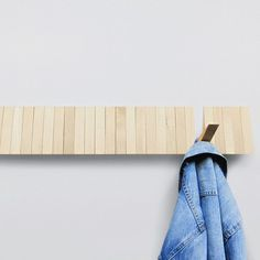 The Switchboard Hanger is a beech wood coat rack with hooks that transform according to your needs. The hanger is ideal for hanging one item or several. To use, simply pull down on a single strip of wood and hang. When not in use, the 25 hooks line up nicely against the wall.