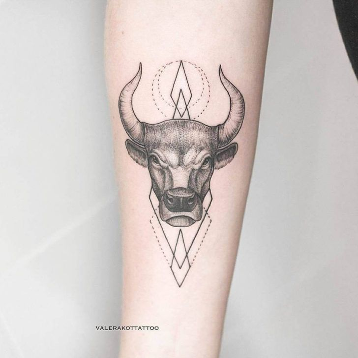 bull tattoo on arm