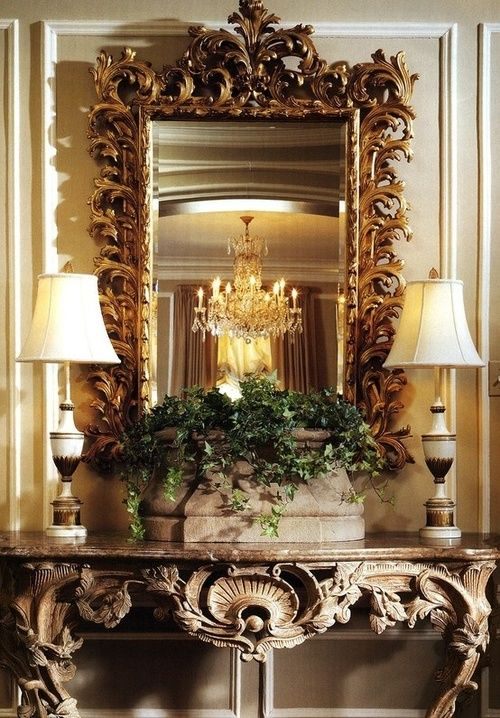 Beautiful ornate mirror + ornate table + symmetry! must. find...