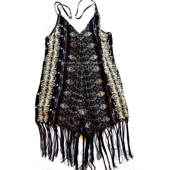 FREE PEOPLE Romper Print Fringe Festival Jumpsuit Size XS. New with tags. $200 Retail + Tax.   Printed shapeless paisley romper with 2 side hip pockets and swingy fringe trim.  Adjustable spaghetti straps. Unlined silhouette.  By Cleobella for Free People.   Rayon. Imported.    ❗️ Please - no trades, PP, holds, or Modeling.    Bundle 2+ items for a 20% discount!    Stop by my closet for even more items from this brand!  ✔️ Items are priced to sell, however reasonable offers will be…