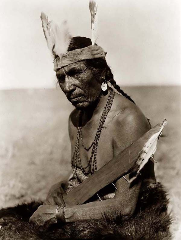 A photograph of Fat Horse, a Blackfoot Indian Brave. It was created in 1927 by Edward S. Curtis.