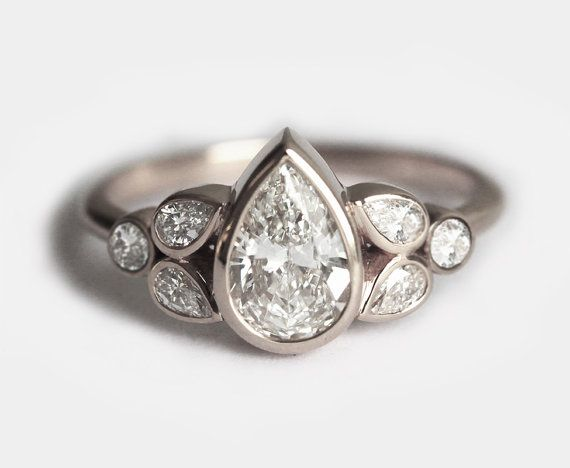 Gorgeous large bezel set pear diamond ring. This sparkly diamond ring comes with GIA certificate. Thir ring features: Gemstone: Diamonds Gemstone