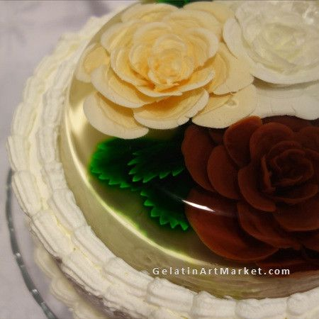 Chocolate and caramel gelatin art flowers on top of the cake