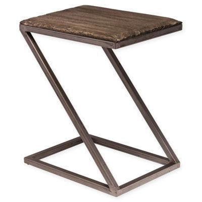 The Lorient Accent Table from Hillsdale Furniture features a minimalist design style. This unique Z-shaped design, features a combination of wood and metal, and a washed charcoal finish, adding simplicity and style to any room décor.