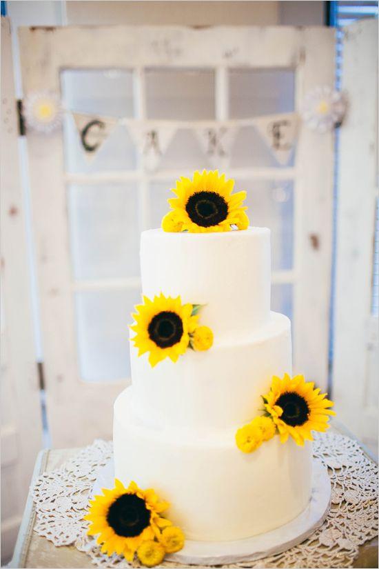 sunflower topped wedding cake @weddingchicks