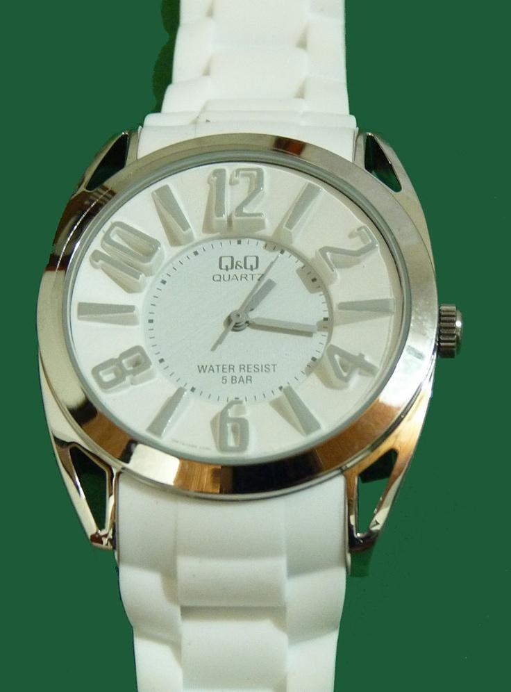 Reloj Q color blanco.