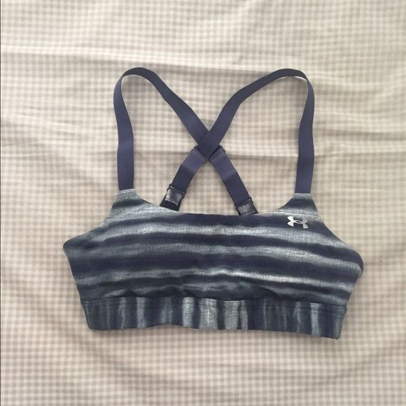 Under Armour sports bra Navy blue and white sports bra with adjustable straps and padding. In great condition. Under Armour Tops