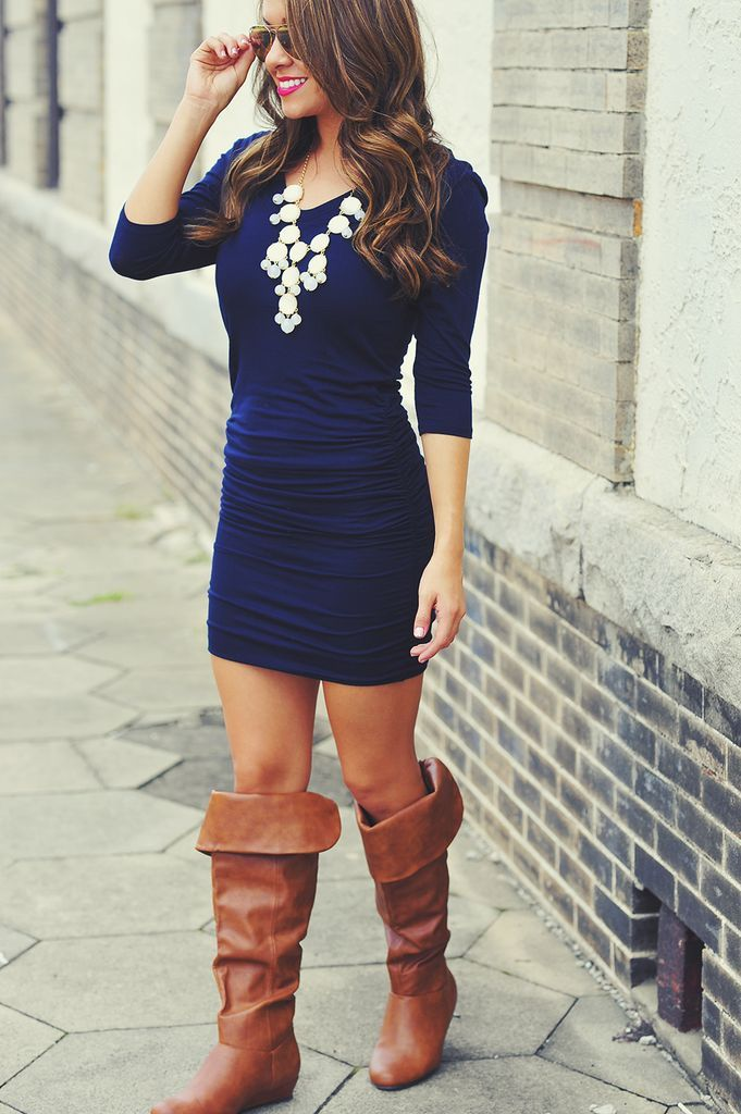 Love the dress and statement necklace....not so crazy about the tops of those boots but like the color!