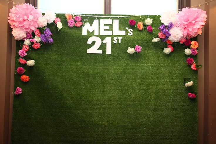 Photo booth #21st #party #ideas #photobooth #backdrop #flowers #grass #pompoms