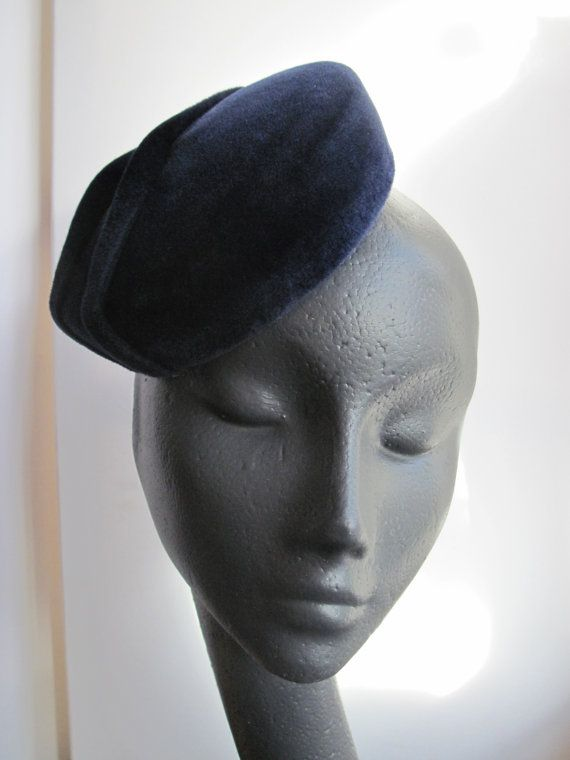 Gorgeous midnight blue velour cocktail hat. The base is handblocked of a lush dark blue velour felt over a buckram base. The hat is decorated with two stylized strips of twisted velour. Lined in kimono silk. The hat attaches with an elastic. Luxurious, stylish and understated. My high quality cocktail hats are made with great care and attention using traditional millinery techniques. They will come in their own hat box for storage, and will be packed securely in sturdy boxes for shippin...