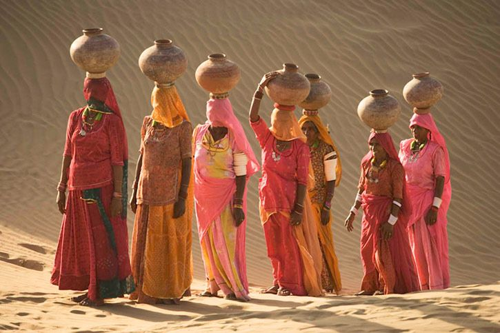 Women bear the responsibility of fetching water from the sparse wells within Rajasthan's vast Thar Desert _ Art Wolf