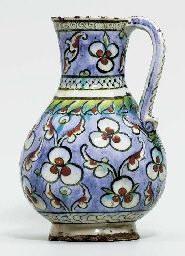 AN IZNIK POTTERY BALUSTER JUG