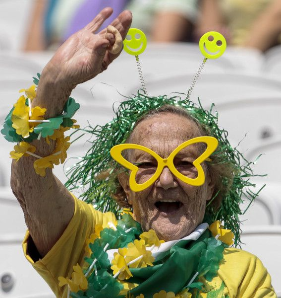 Fans of Brazil cheer their team during the Rio 2016 Olympic Games women's bronze medal football match Brazil vs Canada, at the Arena Corinthians Stadium in Sao Paulo, Brazil on August 19, 2016. / AFP / Miguel SCHINCARIOL