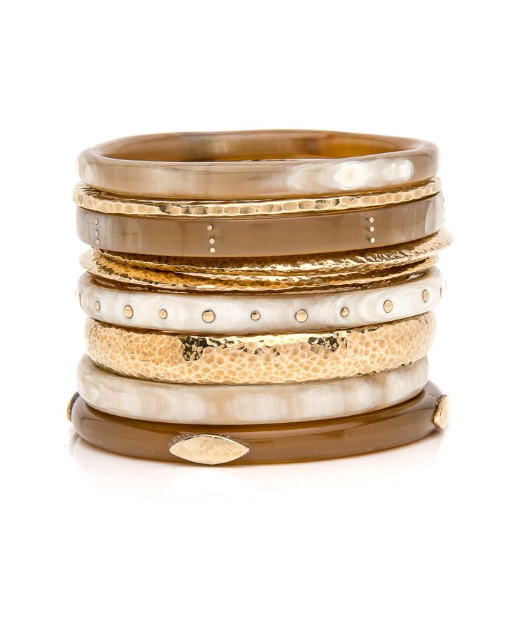 "Ashley Pittman Eneo Light Horn Bangle Set  	Mixed bangle set  	9 piece set  	Hammered bronze and horn bangles  	2.5"" interior diameter  	2.25"" tall  	Horn color and pattern may vary      Ashley Pittman donates 10% of all profits to help fun a rural health center and primary school in Kenya."