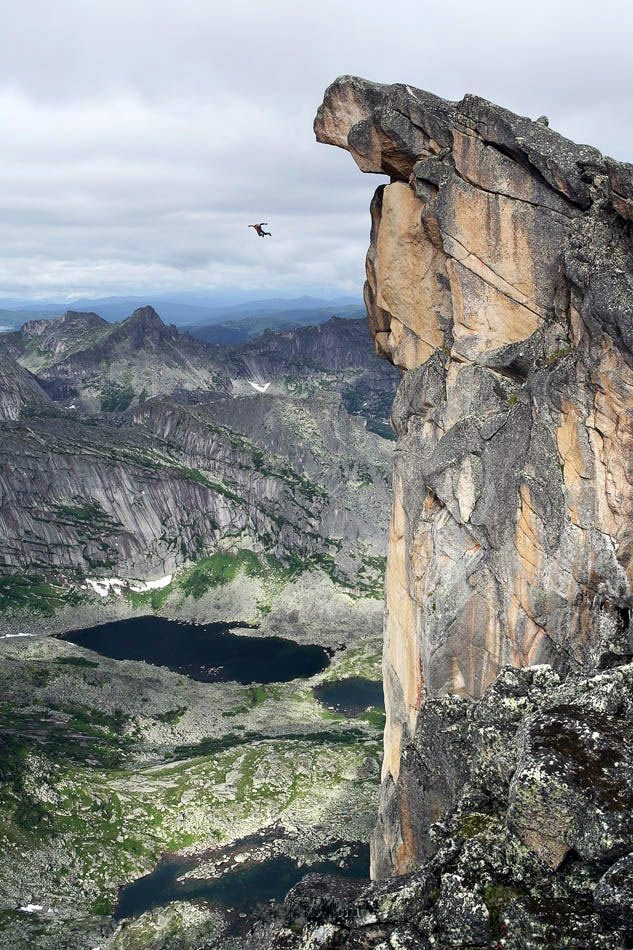 base jumping sky high off a cliff