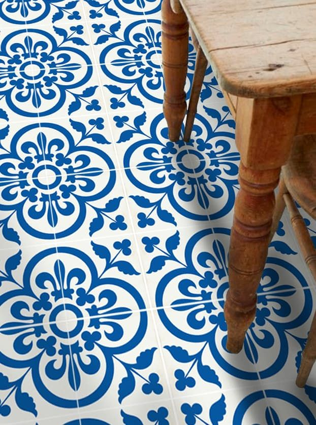 Peel and stick vinyl tile has been around for a long time, but you might be surprised to find that it's suddenly available in a huge variety of colors and patterns, many of which are designed to mimic much more expensive flooring choices, like travertine and cement tile. This is great news for anyone on a budget, because vinyl tile floor are especially budget-friendly — and also easy to install all by yourself.