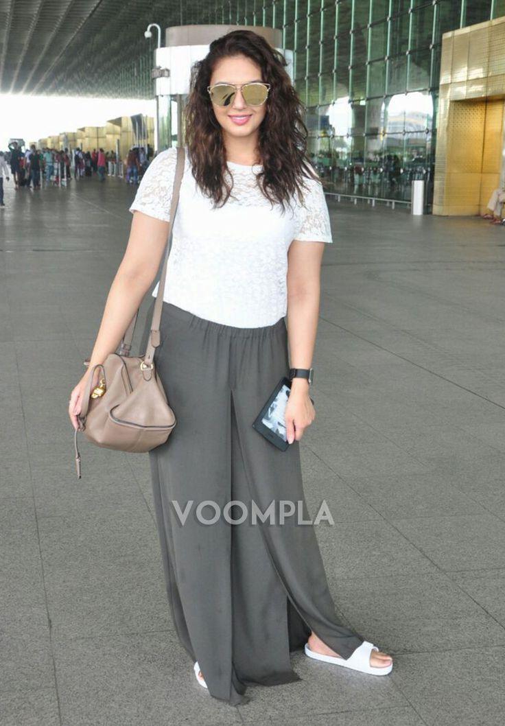 Huma in stylish sunglasses and white net top at Mumbai airport
