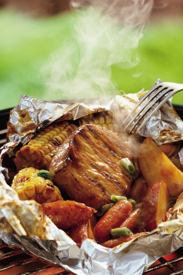 The whole meal is wrapped up into these saucy foil packs: honey barbecue-glazed pork chops, corn, carrots and potatoes. There's hardly any cleanup involved, and dinner's on the table in about 40 minutes. You'll save time by using pre-cooked potato wedges, but feel free to sub in fresh ones instead. Consult the Expert Tips section for directions using fresh—it only takes about 5 more minutes!