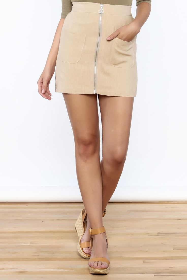 Beige fitted mini skirt with an elasticizedwaistband and a zip-up front closure.   Beige Zip Up Skirt by Pinkyotto. Clothing - Skirts - Pencil & Bodycon Boston, Massachusetts Manhattan, New York City Nolita, Manhattan, New York City