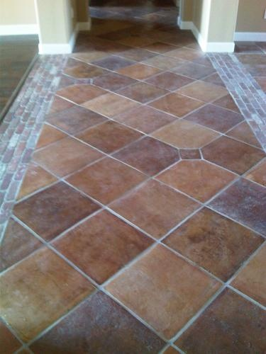 Mexican tile and stone company this would be nice on the for Practical flooring ideas