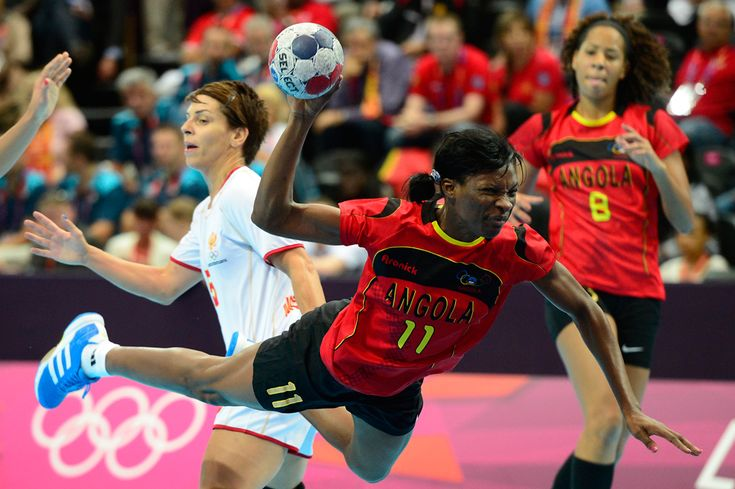 Angola's Luisa Kiala jumps to shoot during the women's preliminaries Group B handball match, August 1, 2012, at the Copper Box hall.