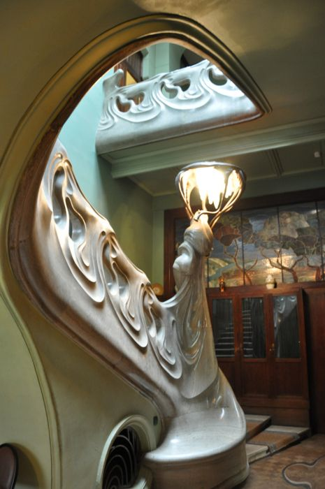 GORKY'S HOUSE: In love with the undulating staircase in the entrance to writer MAXIM GORKY'S home from 1931-6 which is open to the public NATIONAL TRUST style. Other palatial features include intricately formed stained glass windows, and floral mosaic and stucco decorations throughout.   by Vincent Levy