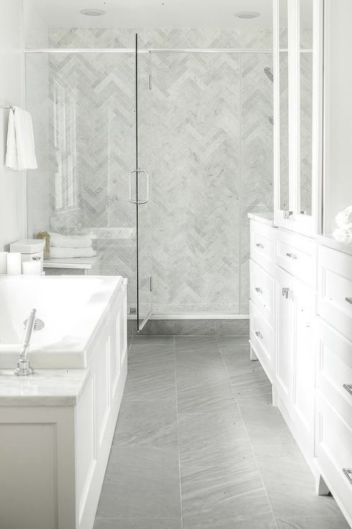 white bathroom with porcelain bathroom floor in dark grey