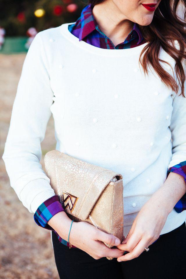 White dot sweater and rich purple plaid shirt.
