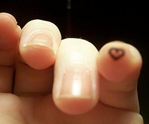 FIngertip heart tattoo. I'd do it on my ring finger though.
