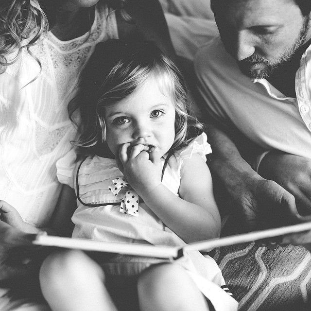 I bet if she could read she wouldn't stop❤️reading to her is fun & she looks so cute trying to