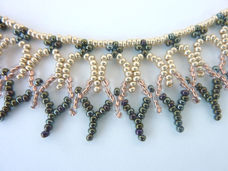 DIY Jewelry: FREE beading pattern for elegant lacy necklace made entirely out of 11/0 seed beads woven in a pattern resembling rows of cathedral windows.
