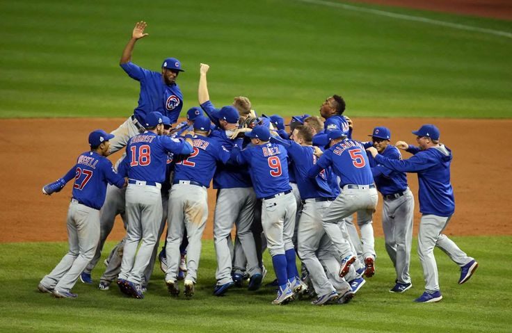 Pictures of the Year 2016:     Sports:    Nov 2, 2016; Cleveland, OH, USA; Chicago Cubs players celebrate after defeating the Cleveland Indians in game seven of the 2016 World Series at Progressive Field.