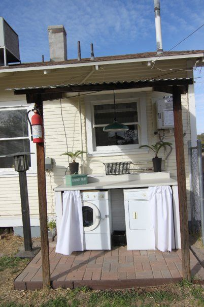 outdoor laundry room - build cabinet around washer/dryer, curtain to hide them, use as a potting station or entertaining! LOVE this idea!! Wonder if a rental would let us do this!