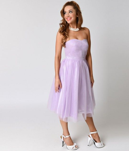 Take Tamara to the top, darlings! Pristinely in line with 1950s vintage prom dresses, Tamara is fresh from Hell Bunny in rockabilly radiance! This bewitching light lavender satin lined tulle dress is gauzy and bolstered with luxurious layers in a straples